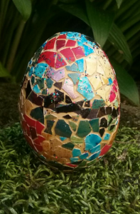 mosaic egg with shells painted with fingernail polish