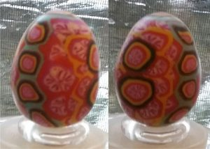 small brown paper and polymer clay egg decorated