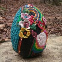 decorated egg with flower petals and polymer clay